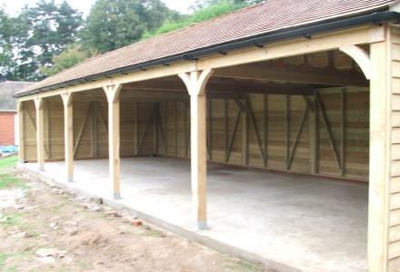 Timber garages carports broadfield stables for Carport dog kennels